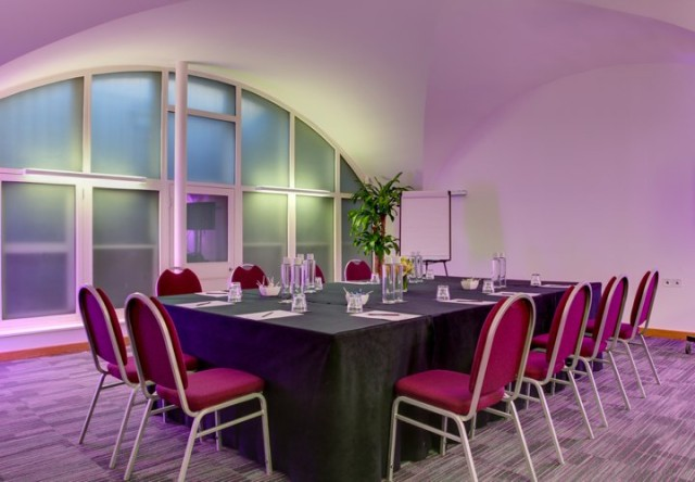 Portland Suite set in boardroom style with red formal chairs and high ceilings Cavendish Conference Centre Venue Hire W1
