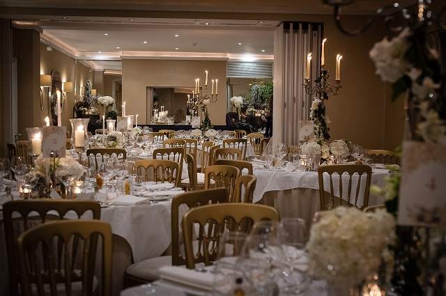 Garden Room set up for a christmas dinner party with tall candelabras and white linen Bingham Hotel Christmas Party TW10