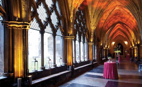 Cloisters set for a christmas drinks reception with views of the college garden and high arched exposed brick work ceilings Westminster Abbey Christmas Party SW1