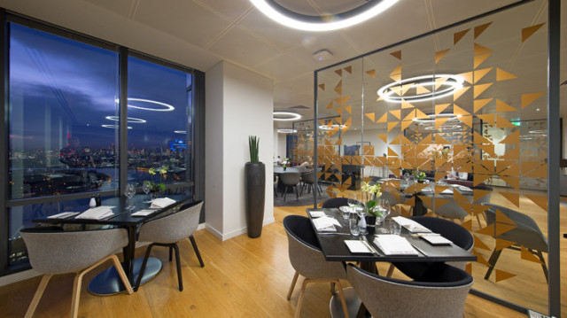 Club Lounge set for a dinner with small tables of 4 with place settings with view of outside from the floor to ceiling windows Level 39 Venue Hire E14