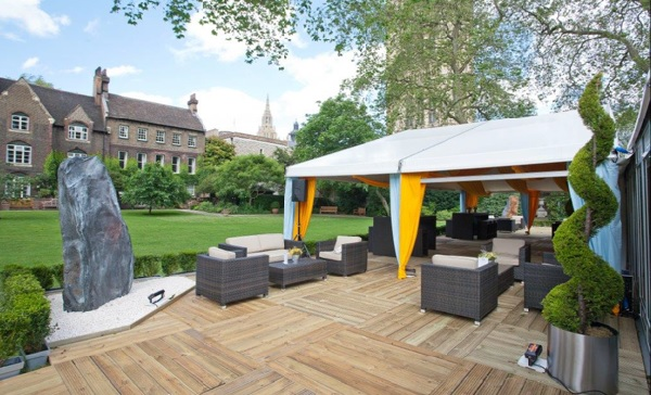 College Garden Marquee with wooden flooring and informal sofa seating under the marquee Westminster Abbey Summer Party SW1