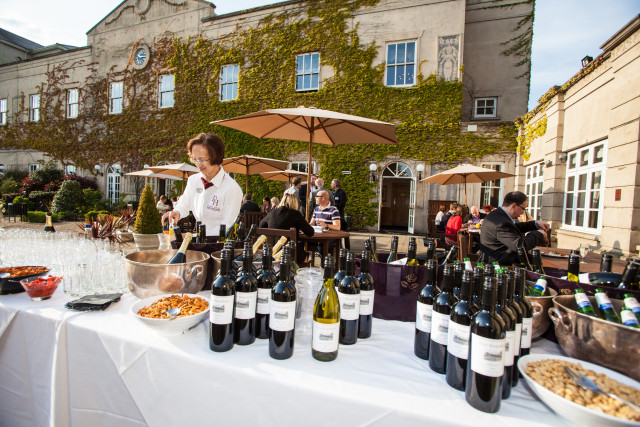 Down Hall Country House Summer Party CM22, outdoor event, patio with seating
