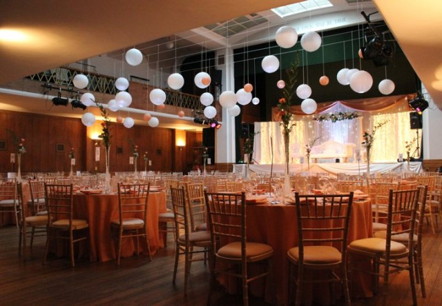 Main Hall set up for a large dinner with round tables dressed for dinner Conway Hall Venue Hire WC1
