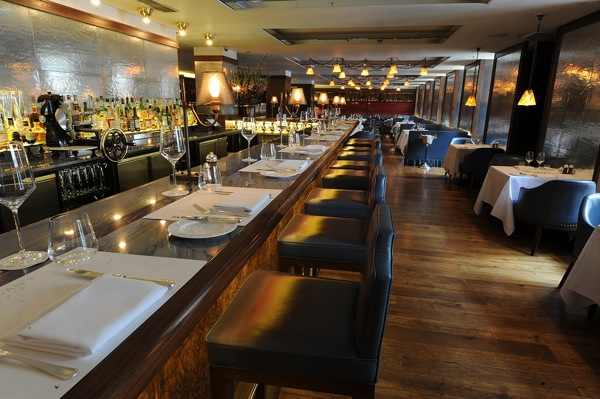 Exclusive Venue Hire view view of the bar and high seating and restaurant set for dinner Corrigan's Mayfair Venue Hire W1