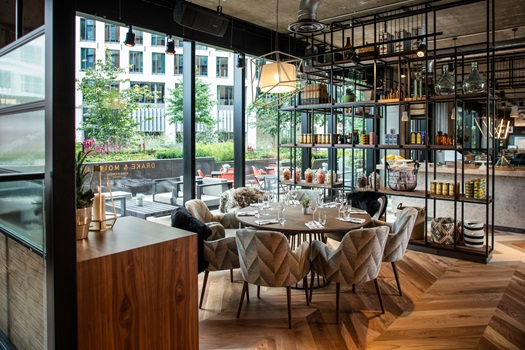 Restaurant with patterned wooden floor and contemporary decor with formal table layout and view of the bar Drake & Morgan Kings Cross Venue Hire N1