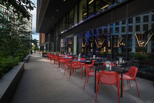 Outside Area with view of the high street and bright red furniture set out for lunch Drake & Morgan Kings Cross Summer Party N1