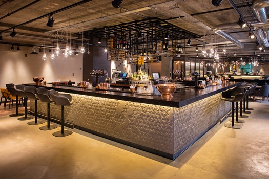 view of the bar with bright under lighting and high chairs surrounding the bar Drake & Morgan Kings Cross Venue Hire N1
