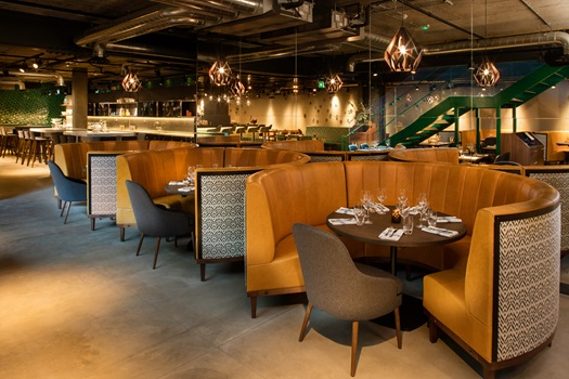Restaurant with formal and modern round booth seating with view of the bar Drake & Morgan Kings Cross Venue Hire N1