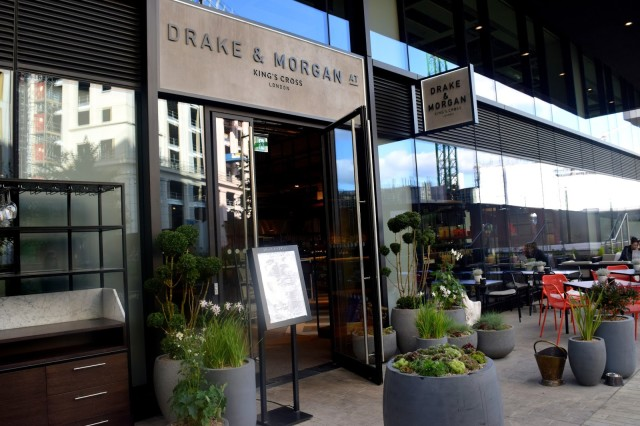 Entrance with potted plants and floor to ceiling windows Drake & Morgan Kings Cross Christmas Party N1