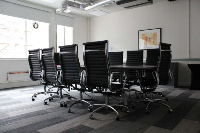 Meeting Room set in boardroom style with sleek tall black office chairs and natural daylight Marble Arch Venue Hire W1
