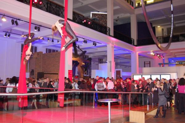 Ariel Performance in the Energy Hall with guests enjoying a standing reception Science Museum Christmas Party SW7