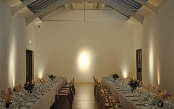 Whitechapel Gallery Christmas Party E1 Gallery 8 set for a christmas party with long banqueting tables dressed in white table linen and high ceilings Whitechapel Gallery Christmas Party E1