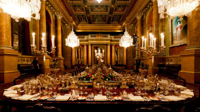 Livery Hall set for a large Christmas banquet with high extravagant ceilings and long oak tables set for dinner Goldsmiths' Hall Christmas Party EC2