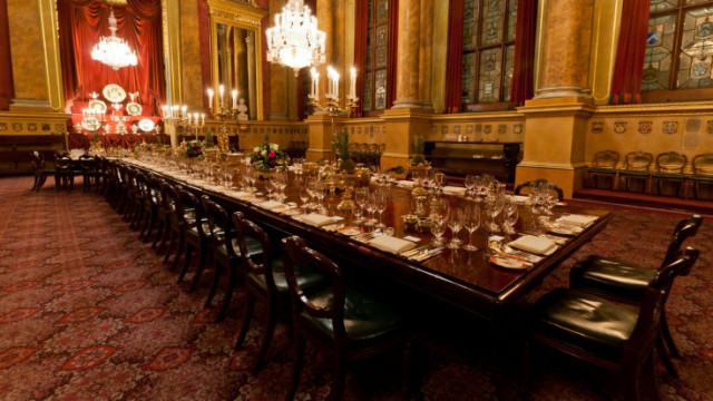Exhibition Room set for a Christmas banquet with low chandeliers and oak table Goldsmiths' Hall Christmas Party EC2