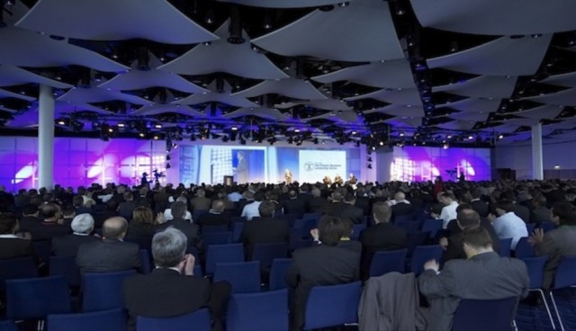 Great Hall set for a large conference with chairs set in theatre style with a stage and large screens at the front of the room Wembley Stadium Christmas Party HA9