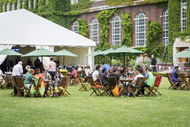 York Lawn Furniture and Marquee set for a BBQ with informal seating with green parasols Regent's Conferences and Events Summer Party NW1