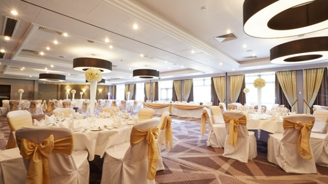 DoubleTree Hilton Ealing Shared Christmas Party W5, seated dinner, natural daylight, round tables festive decorations