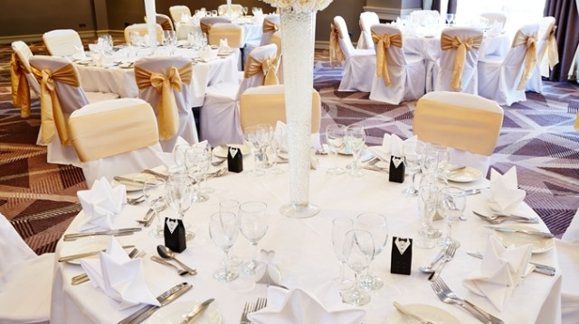 DoubleTree Hilton Ealing Shared Christmas Party W5, seated dinner set up, centre pieces, chair covers