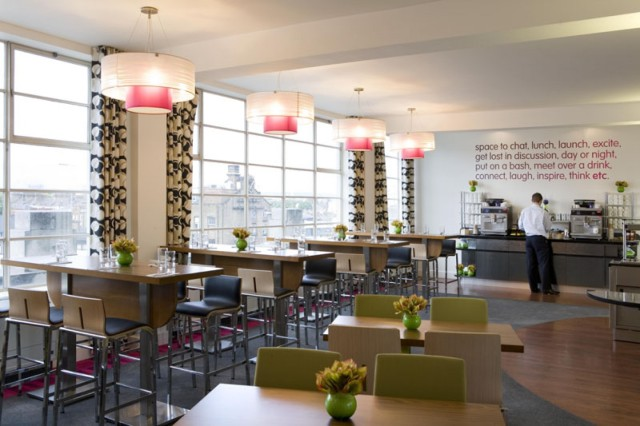 Dining Room with large windows for lots of natural daylight and high tables and chairs The Hatton Venue Hire EC1