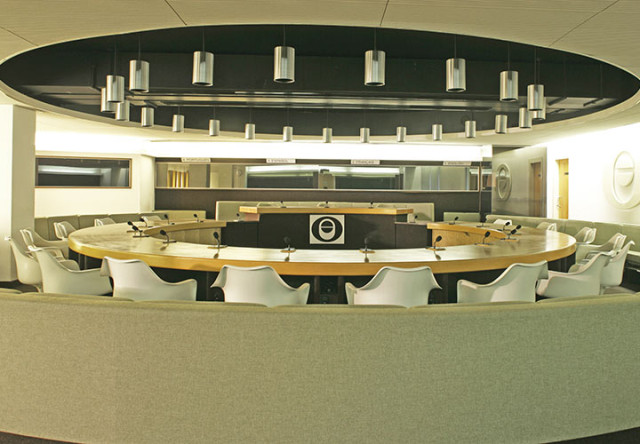 Boardroom set in a circular shape with pin spot lights in the ceiling and tired seating ICO Conference Centre Venue Hire W1