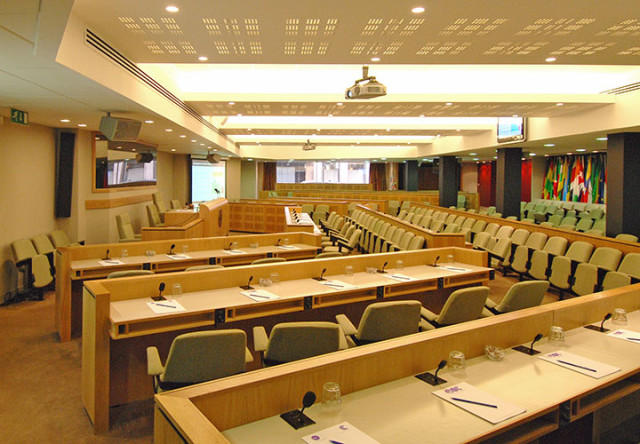 Council Chamber with tired seating facing the front of the room with screen projected on to the wall ICO Conference Centre Venue Hire W1