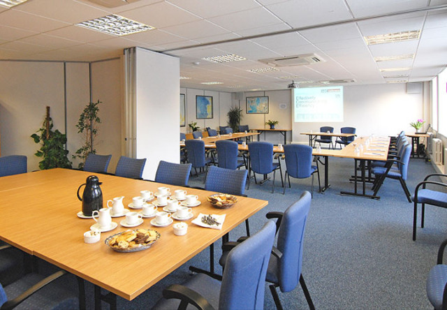 Meeting Room set in classroom style and tea and coffee set out with screen projected onto the wall ICO Conference Centre Venue Hire W1