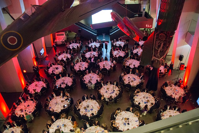 IWM Summer Party London SE1. Inside of event space, tables set out for seated dinner.