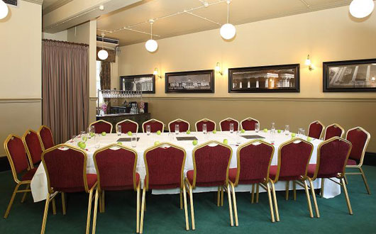 Judges Chamber Rooms set for a board meeting with a large boardroom table with white linen at Browns Covent Garden Venue Hire WC2