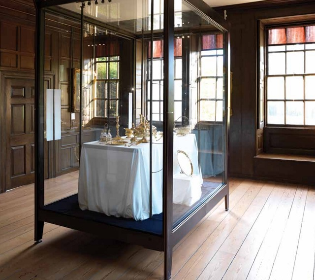 Kings Breakfast Room with display cabinet in the centre of the room with nautral daylight and oak paneled windows Kew Palace Venue Hire TW9