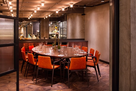 Private Dining Room set in banqueting style on oval table with mirrored walls Drake & Morgan Kings Cross Venue Hire N1