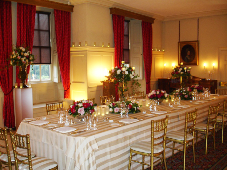 Kings Dining Room set for a private Christmas meal with formal place settings and smart table linen with winter foliage decorating the table Kew Palace Christmas Party TW9