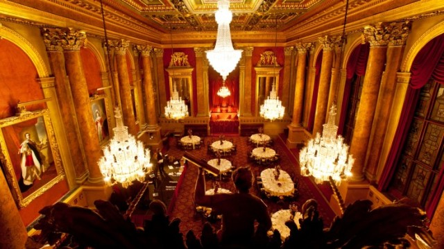 Livery Hall set for a large dinner with round tables dressed in white linen high ceilings and 5 large chandeliers lighting up the room Goldsmiths' Hall Venue Hire EC2