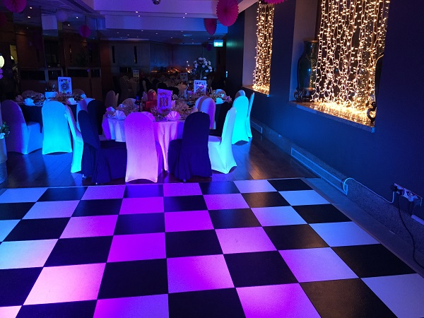 Washington Mayfair Hotel Christmas Party W1J. Themed Christmas at hotel with banqueting tables and dance floor or black and whites squares