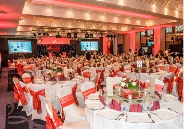 Montcalm Hotel Christmas Party W1. Large space decorated with tables and chairs set up for a christmas dinner