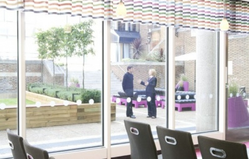 Meeting Room with view of the outside garden with glass doors One Drummond Gate Venue Hire SW1