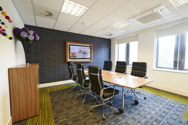 Meeting Room set up for a boardroom set for 6 delegate with screen facilities and natural daylight with smart high black leather seats House Venue Hire SE1
