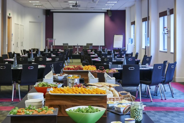Illuminate Suite in classroom style for a meeting with presentation facilities and food stand at the back of the room Prospero House Venue Hire SE1