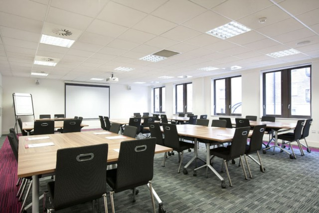 Meeting Room in classroom style with presentation facilities at the front of the room with natural daylight House Venue Hire SE1