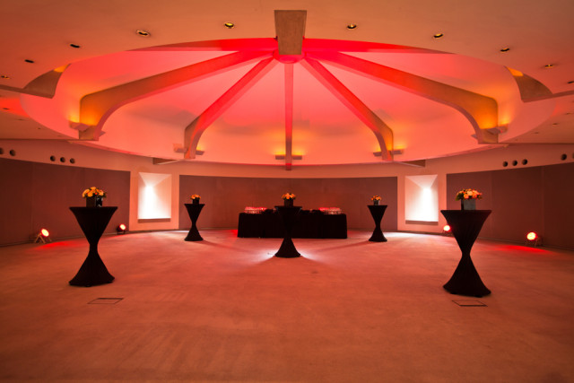 Council Chamber with pink uplighting and circular roof for excellent acoustics with built in hidden windows for natural daylight Royal College of Physicians Venue Hire NW1