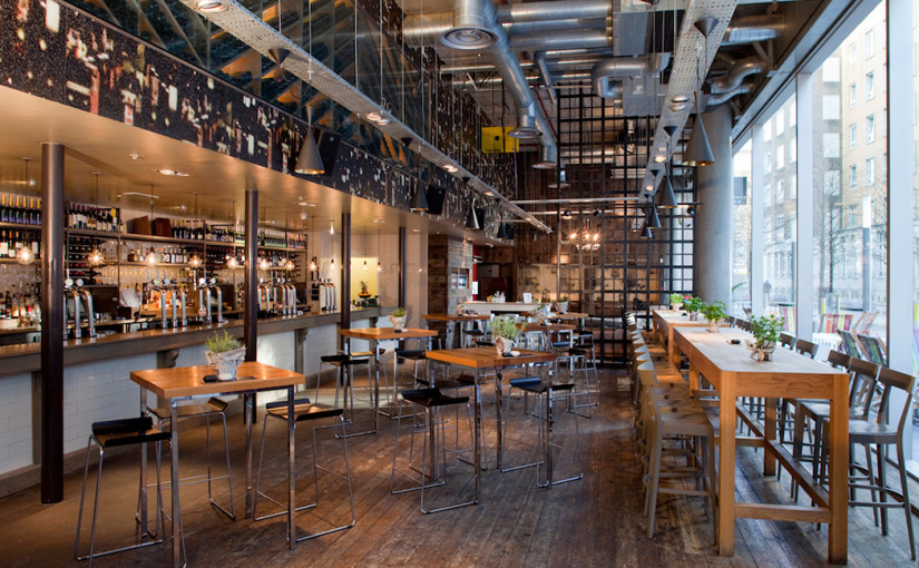View of the bar with high tables and stools and lots of natural dayilght with floor to ceiling windows Refinery Bankside Venue Hire SE1
