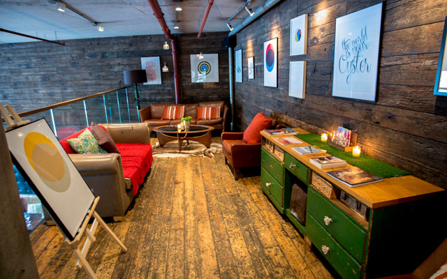 Mezzanine level of the venue with informal and colourful sofa seating and shabby chic wooden flooring Refinery Bankside Venue Hire SE1