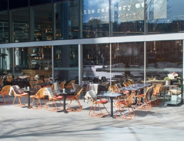 Refinery Regents Place Summer Party NW1. Tables and chairs set up outside for guests to eat and drink.