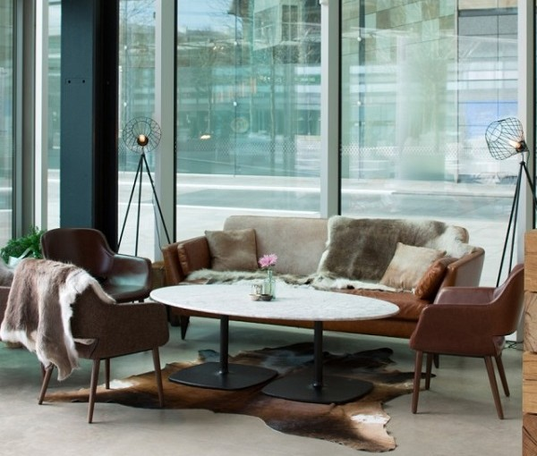 Refinery Regents Place Christmas Party NW1. Lounge area of The Refinery with sofas with furr blankets on sofas.