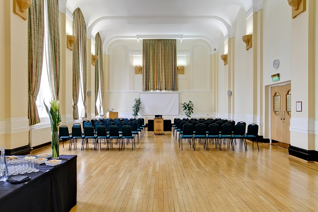 Herringham Hall set in theatre style for a presentation with presentation facilities and high ceilings with tall windows Regent's Conferences and Events Venue Hire NW1