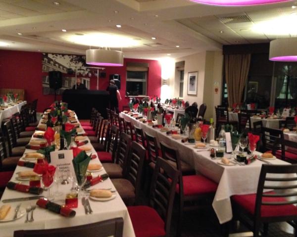 Devonport House Christmas Party SE10, seated dinner, long tables, festive novelties