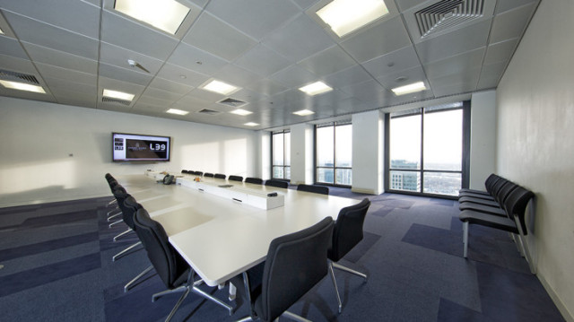 Future Minster Sandbox Space set out for a conference in boardroom style with lots of natural daylight Level 39 Venue Hire E14
