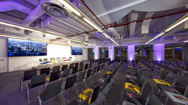 Space 39 set for a conference set out in theatre style with views over Canary Wharf with floor to ceiling windows Level 39 Venue Hire E14