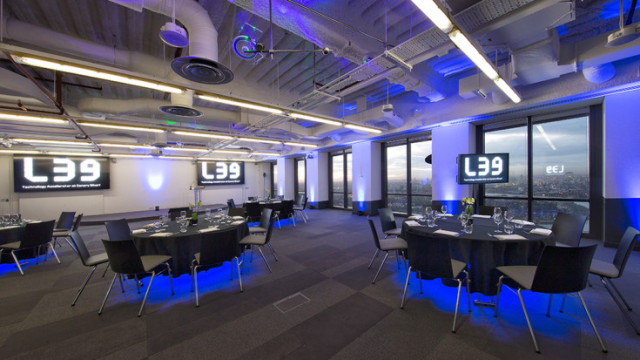 Space 39 set for a Christmas party with lights shining under the table and natural daylight over Canary Wharf Level 39 Venue Hire E14