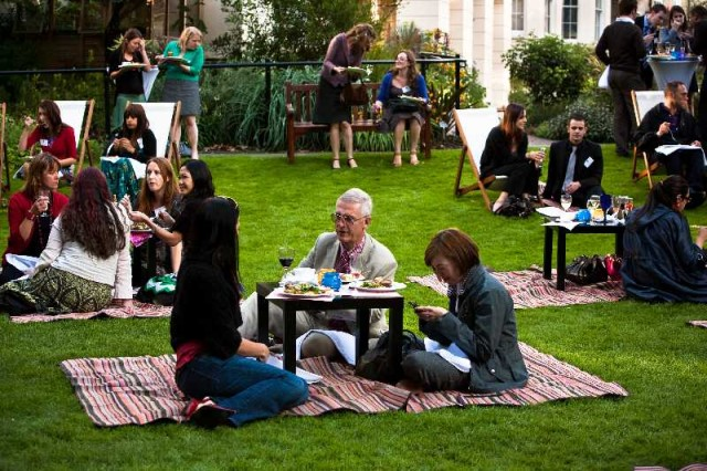 Garden Party with guests enjoying lunch on a picnic blanket and small table Royal College of Physicians Venue Hire NW1