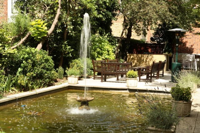 Kensington Close Hotel Summer Party , seated outside area, exclusive garden hire, waterfall